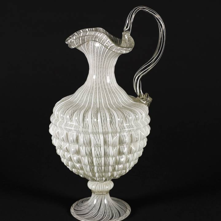 Photograph of a white patterned Venetian glass vessel