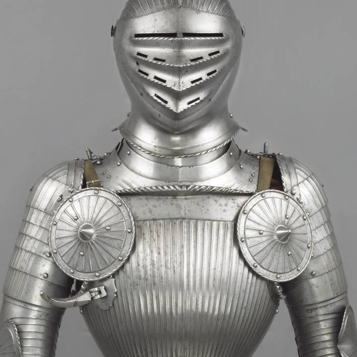 Photograph of body and head of an early sixteenth century suit of armour