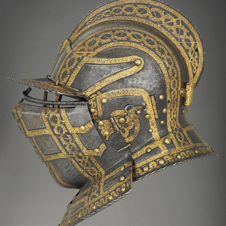 Side view of sixteenth century helmet with visor with gold detailing