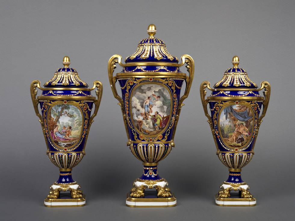 Three blue vases with mythological images on the front