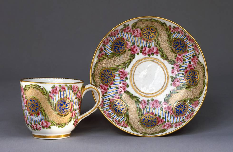 One cup and saucer with rose garlands and sage entwined