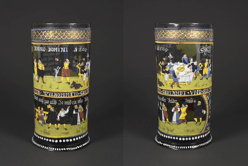 Drinking scenes and inscriptions on a drinking cup