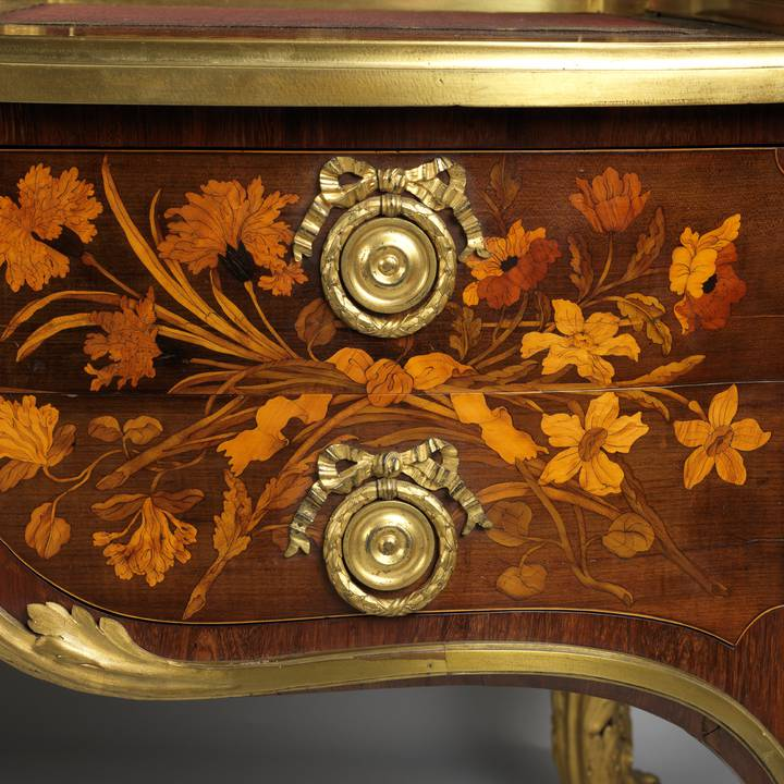 A detail of floral marquetry on a roll-top desk