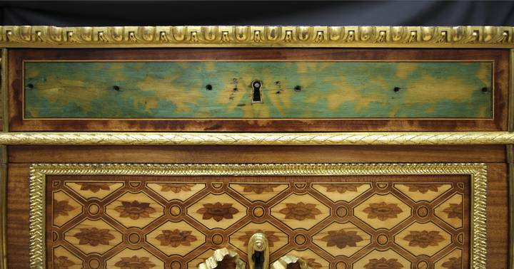 Detail of blue-stained marquetry in the frieze, which has escaped light damage. Attributed to Jean-Henri Riesener, Chest-of-drawers, 1780 (F247).