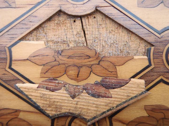 Detail of the underside of a piece of trellis marquetry, showing some of its original colours. Attributed to Jean-Henri Riesener, Chest-of-drawers, 1780 (F247).