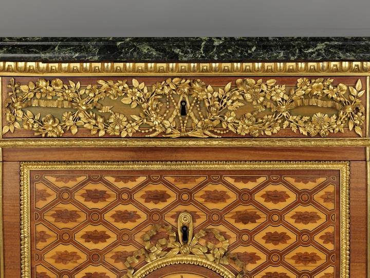 Detail of floral gilt-bronze frieze and Marie-Antoinette's cipher. Chest-of-drawers (F247).