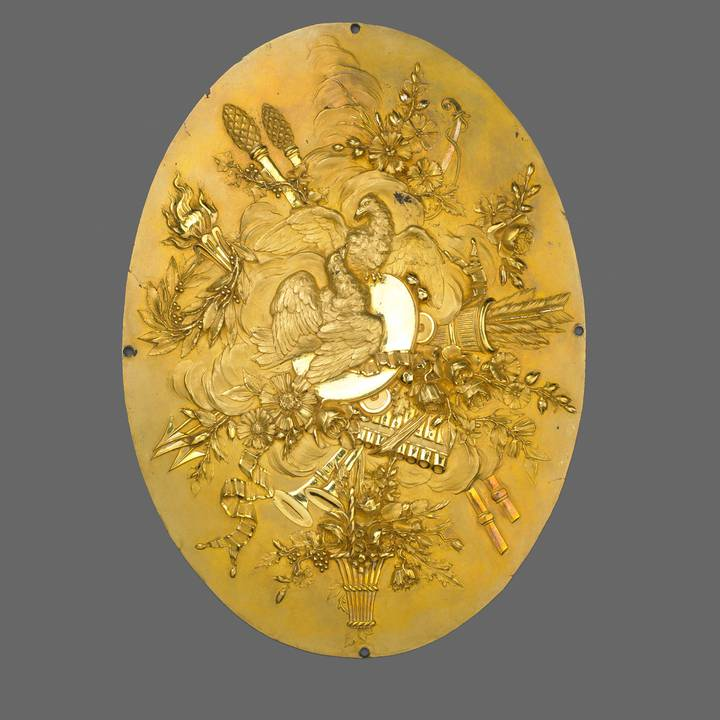 A gilt-bronze plaque showing the attributes of Love