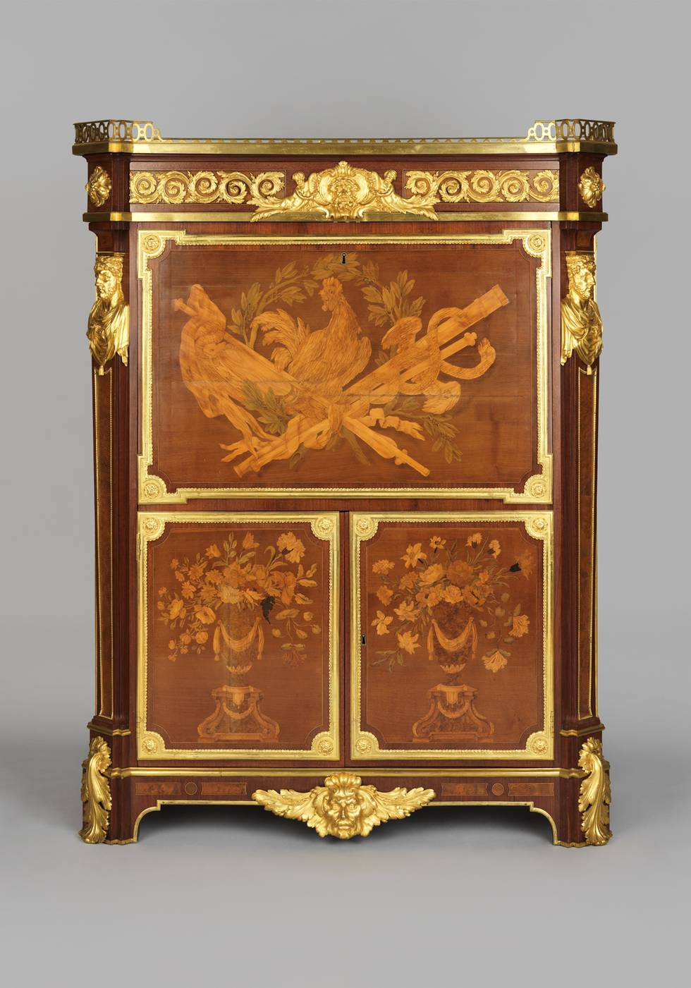 A marquetry fall-front desk