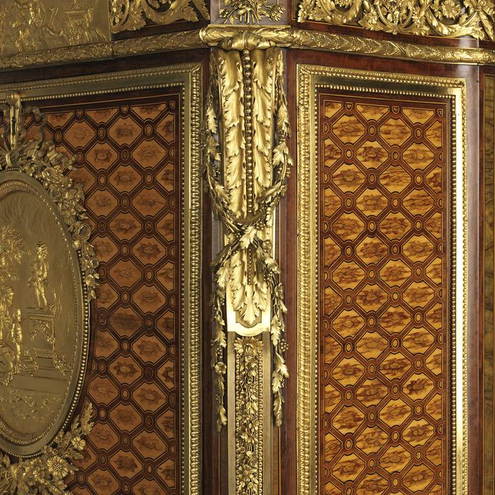 Detail of gilt-bronze mounts on corner of desk