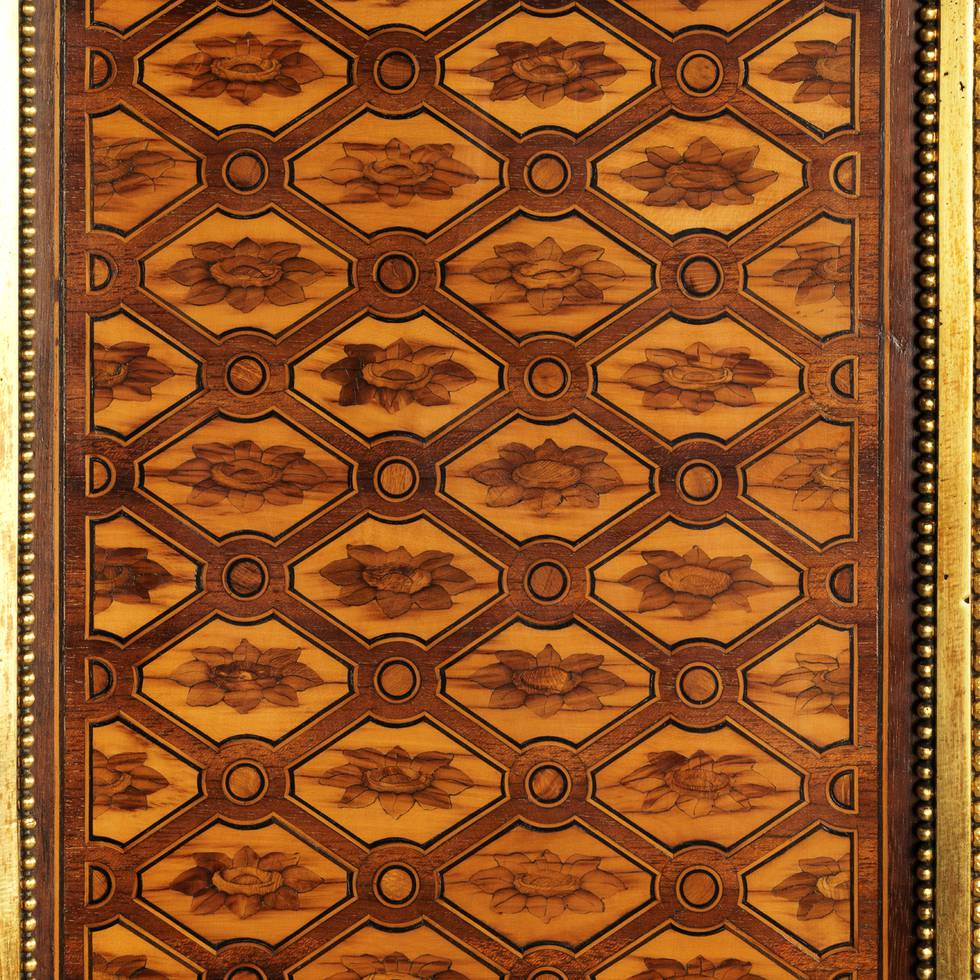 Detail of wooden paneling with a repeated flower pattern