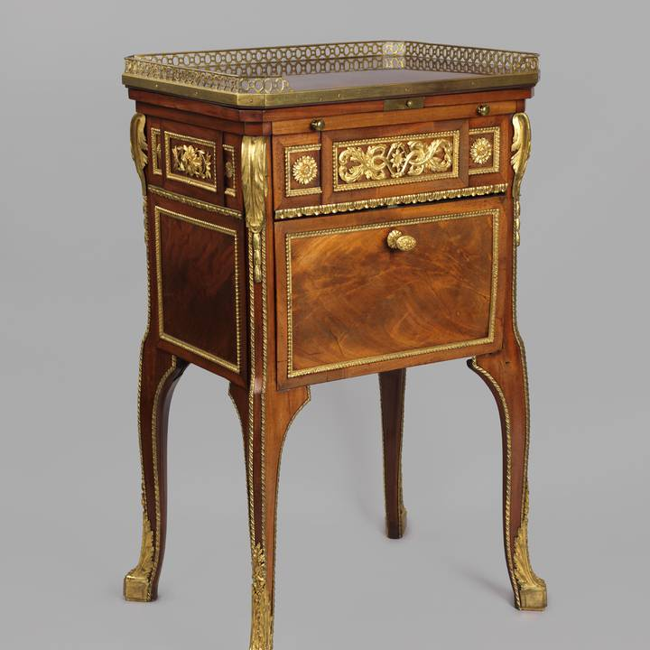 A mahogany-veneered writing and toilet table