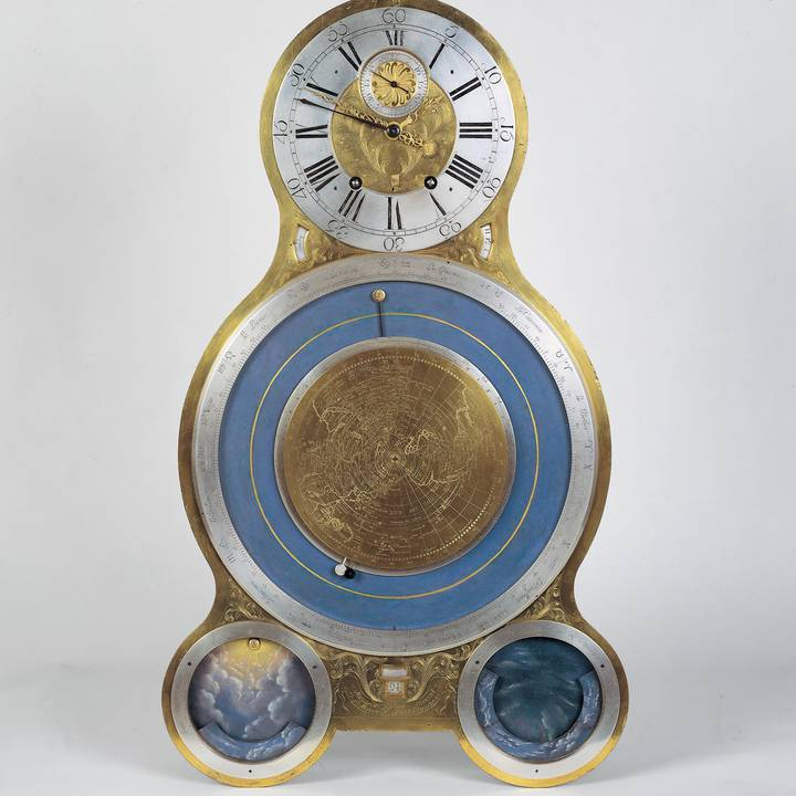 Gold and blue clock face with four dials