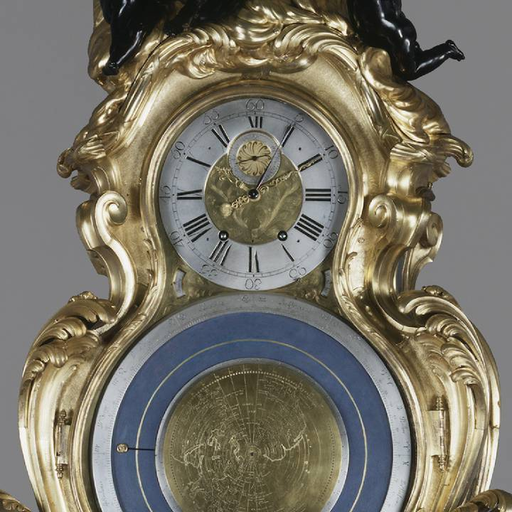 Gold and blue clock face and astronomical dial