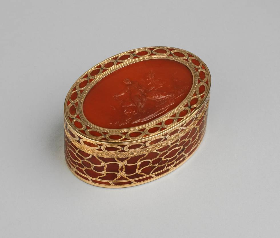 Elevated side view of orange hardstone and gold box