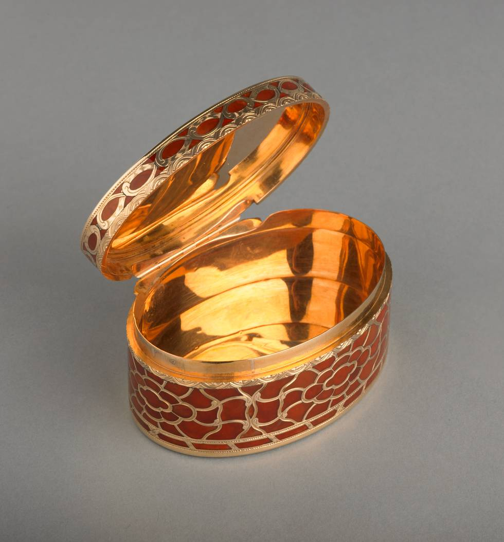 Open view of orange hardstone and gold box