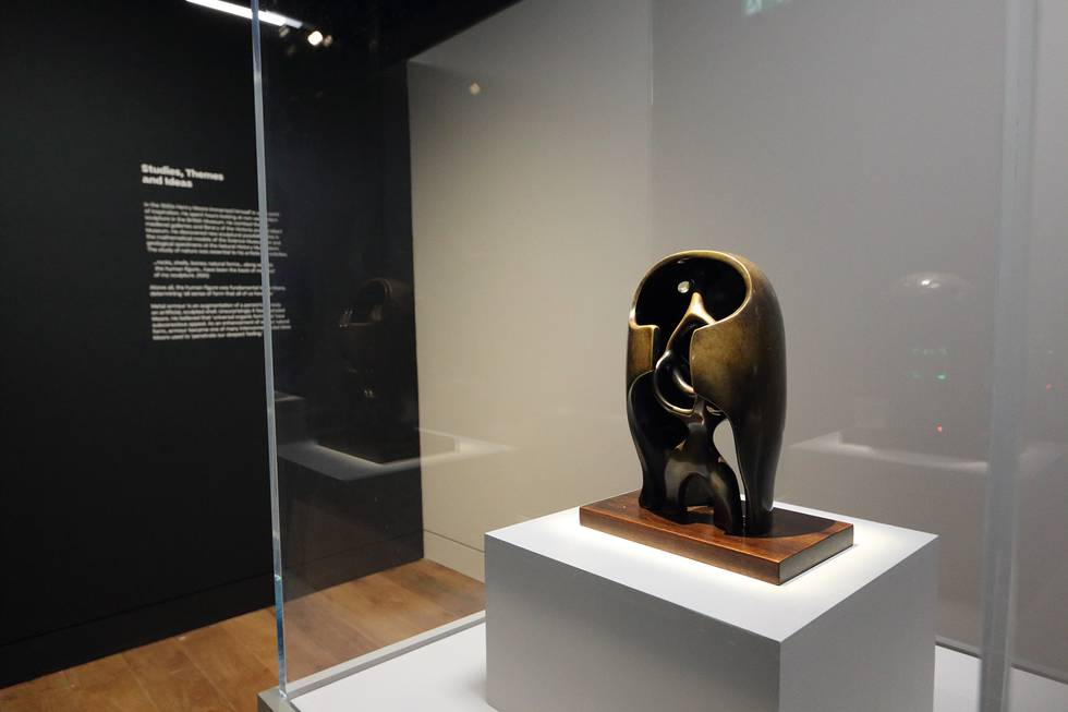 A sculpture by Henry Moore in a cabinet in an exhibition
