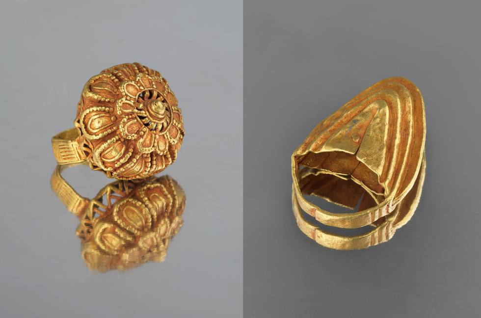 Two gold rings, both chunky shapes on a band