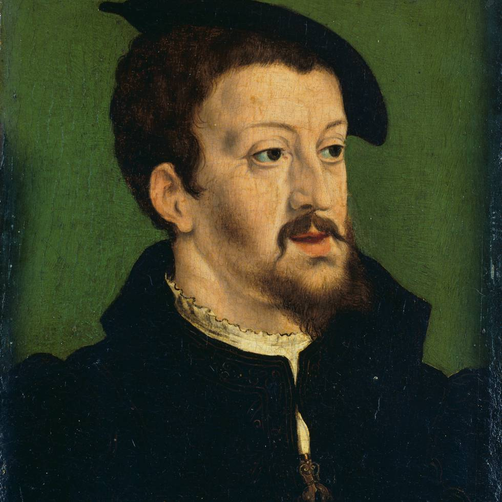 Portrait of a man with a goatee on a green background
