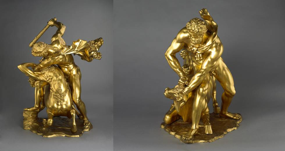Side view of two bronze sculptures of a man fighting a bull and centaur
