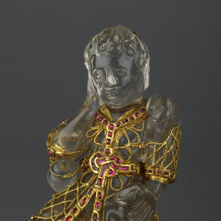 Three-quarter length of statue of christ as a Shepard, decorated with gold and jewels