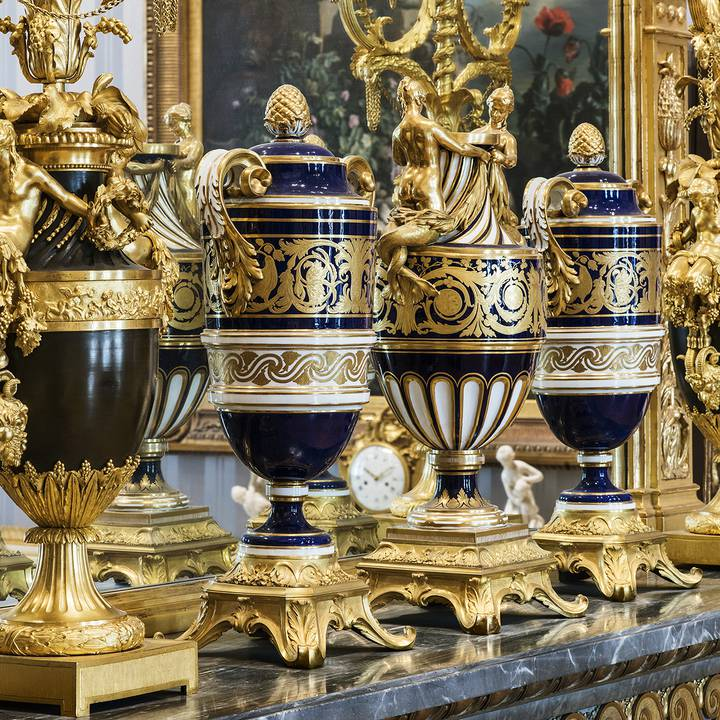 Ornate blue and gold urns on a shelf