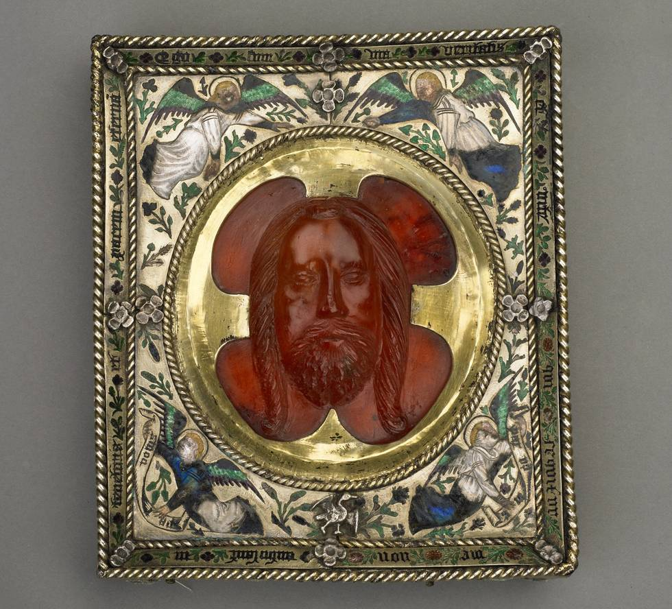 Head of Christ carved in amber on a square silver frame